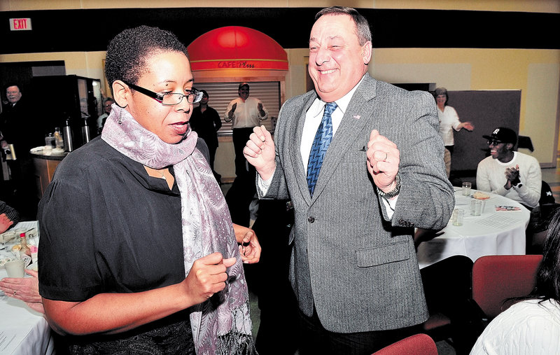 Martin Luther King Jr. Day keynote speaker the Rev. Effie McClain of Oakland and Gov. Paul LePage dance during a community breakfast in Waterville on Monday, with music from the Colby College African Drummers Ensemble.