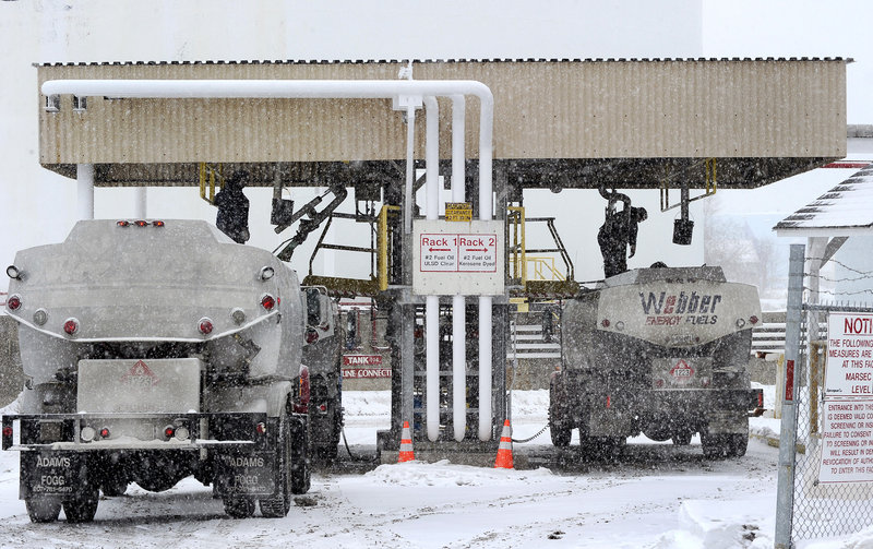 Oil dealers' trucks fill up at the Sprague Energy facility in South Portland last week. The statewide average price of No. 2 heating oil has been rising steadily and is currently more than $3 a gallon, a price that hadn't been seen here since 2008.
