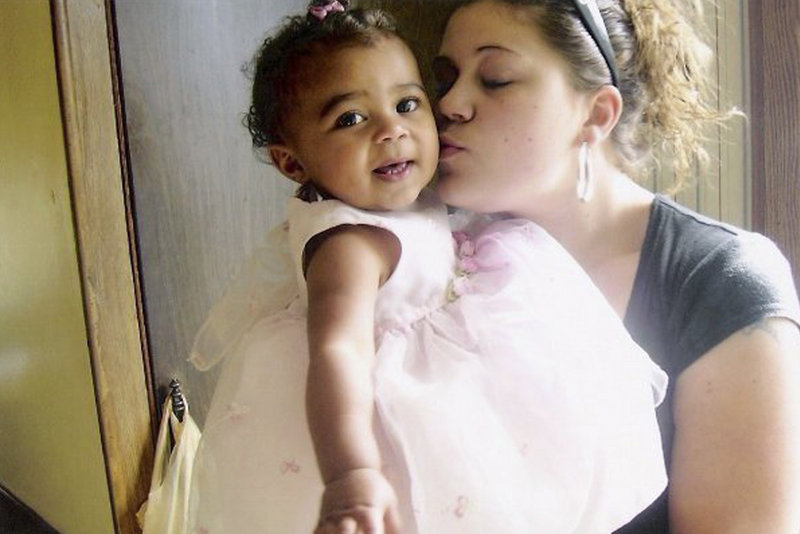 Megan Waterman kisses her daughter, Lily, now 4. Friends and family say Waterman agreed to work as a prostitute at the urging of her boyfriend, Akeem Cruz.