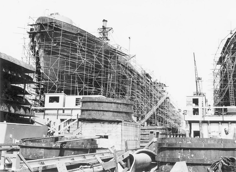 An archival photo shows a Liberty ship under construction.