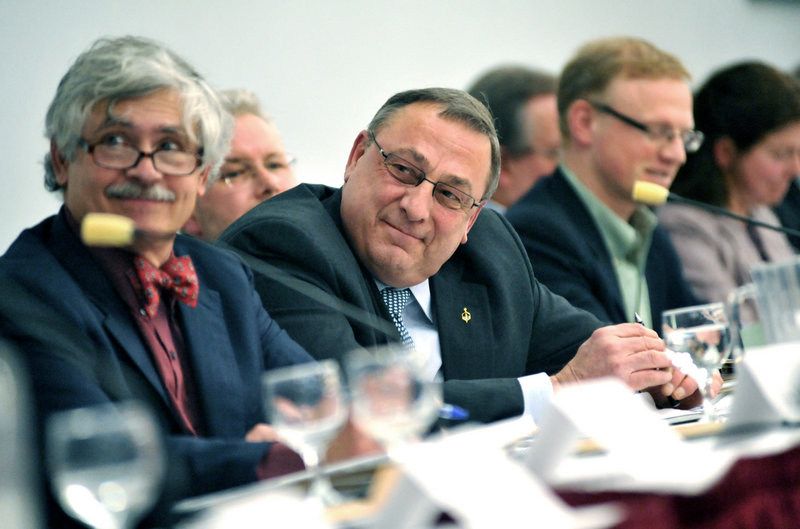 Gov. Paul LePage, center, listens as panel members speak about environmental concerns Thursday during the Roundtable on Maine People and the Environment.