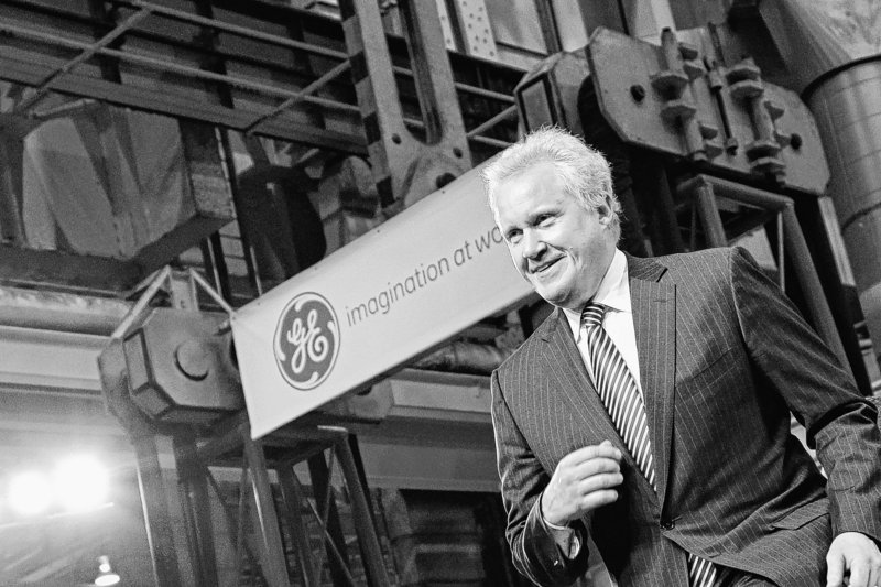 General Electric CEO Jeffrey Immelt strides to the stage Friday at the GE plant in Schenectady, N.Y., to introduce President Obama. Obama announced a restructured presidential board to be led by Immelt that focuses on increasing employment and competitiveness. GE's fourth-quarter profit climbed 51 percent, and revenue also beat analysts' expectations.