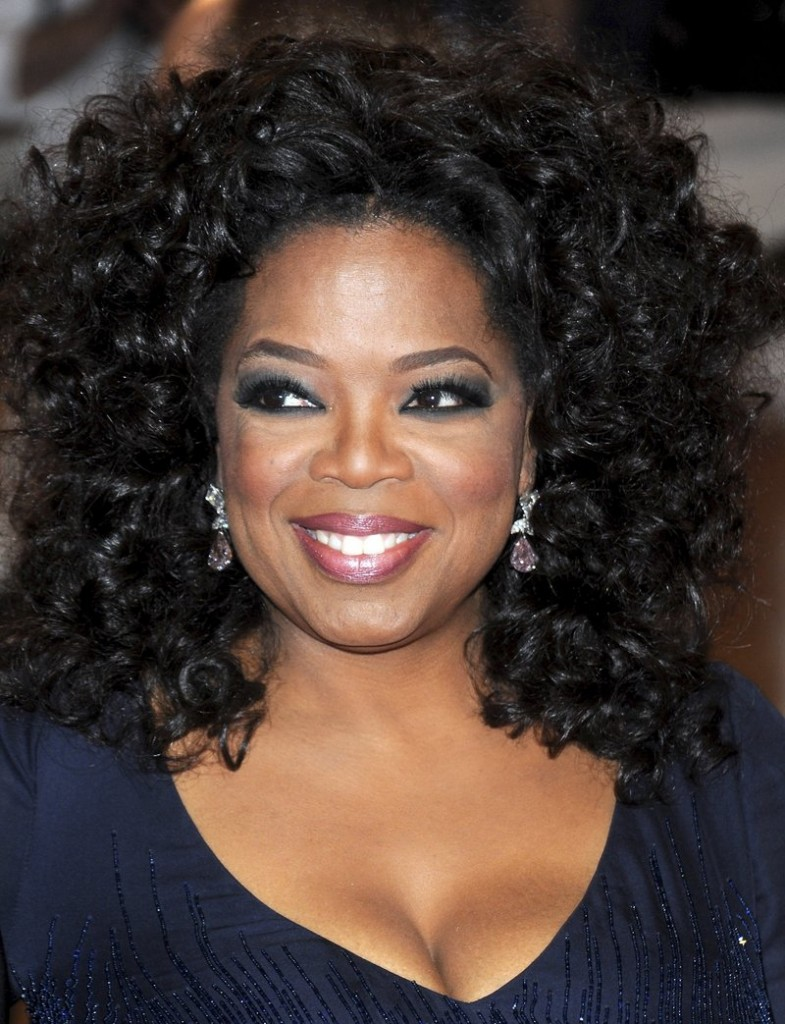 Oprah Winfrey, shown arriving at a New York gala last May, is titillating viewers with a promise of a major revelation and personal reunion on Monday's show.