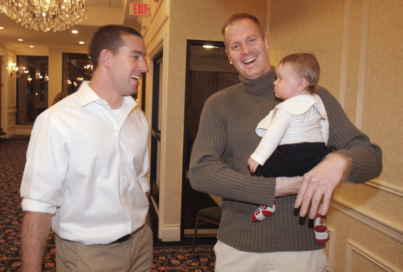 Ryan Kalish, left, a former Sea Dog who spent part of last season with the Red Sox, talks with Mark Nielsen and his son Nevyn at the Sea Dogs' annual hot stove dinner Friday night.