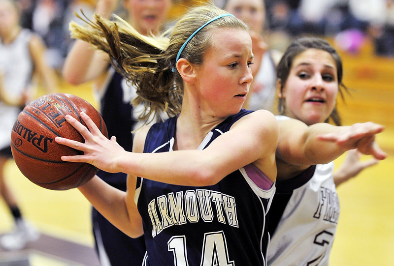 Alexa Sullivan of Yarmouth keeps the ball from going out of bounds and holds it away from Alexandra Mitch of Freeport in the second half of their Western Maine Conference game Friday. Freeport earned a 42-31 victory at home.