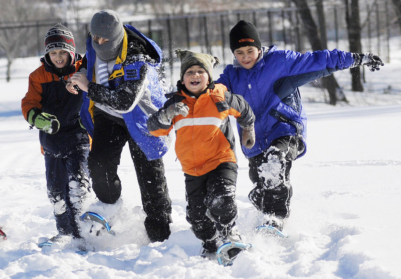 Iraqi immigrants, from left, Salar Salim, 9, Salim Salim, 12, Khalil Mohammad Sheet, 7, and Mohammad Sheet, 11, play in the snow at the 7th annual Welcome to Winter Festival hosted by WinterKids in Payson Park on Saturday.
