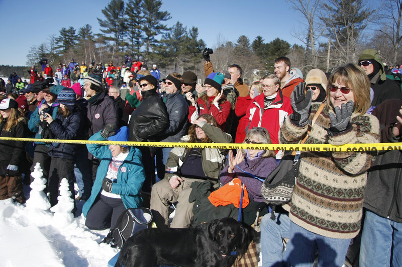 Spectators cheer for polar dippers. Proceeds benefited Animal Hills Animal Shelter.