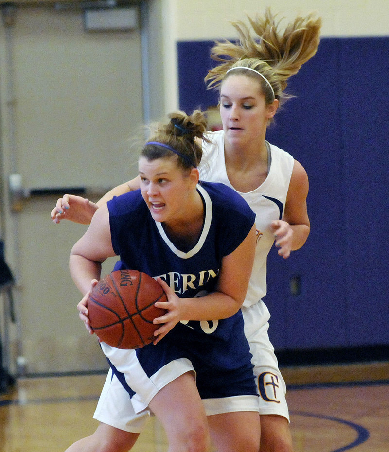 Kayla Burchill of Deering looks for an open teammate Saturday while guarded by Brooke Flaherty of Cheverus. Burchill scored 24 points to help the Rams remain undefeated with a 56-44 victory at Cheverus High.