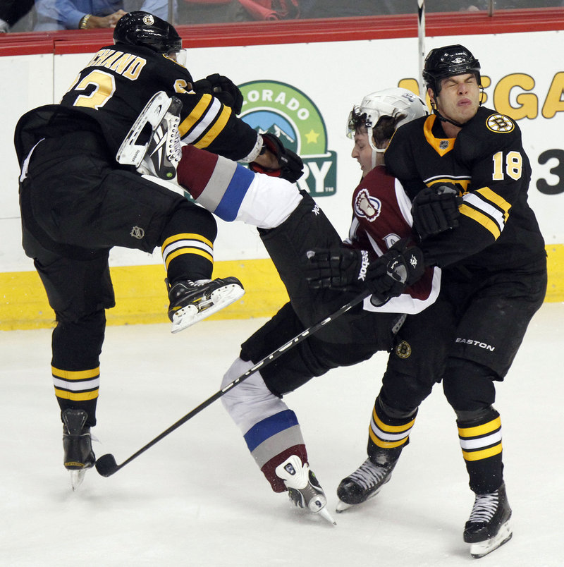 Boston's Brad Marchand, left, and Nathan Horton collide with Colorado's Matt Duchene during the Bruins' 6-2 win Saturday. It was Boston's third win in four games.