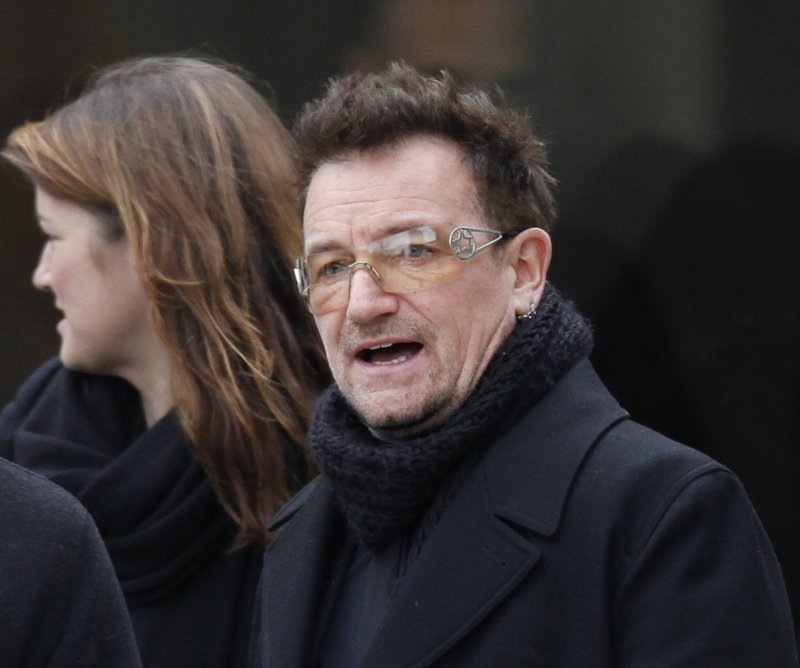 Rock singer Bono leaves following the funeral of R. Sargent Shriver at Our Lady of Mercy Catholic church in Potomac, Md., on Saturday. Bono worked with Shriver's eldest son.