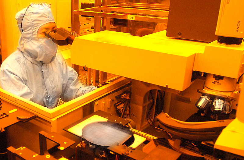 A worker inspects a wafer at Fairchild Semiconductor in South Portland. Both Fairchild and National Semiconductor would like Maine's solvent regulations to be aligned with less-strict federal laws.