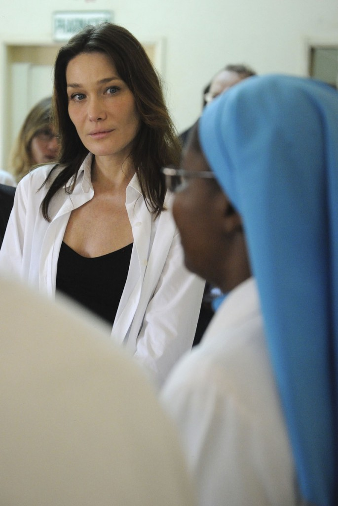French first lady Carla Bruni-Sarkozy talks to a nun doctor during a visit to Benin last January on behalf of the Global Fund to Fight AIDS, Tuberculosis and Malaria. An inquiry is focusing on the possible misuse of the money.