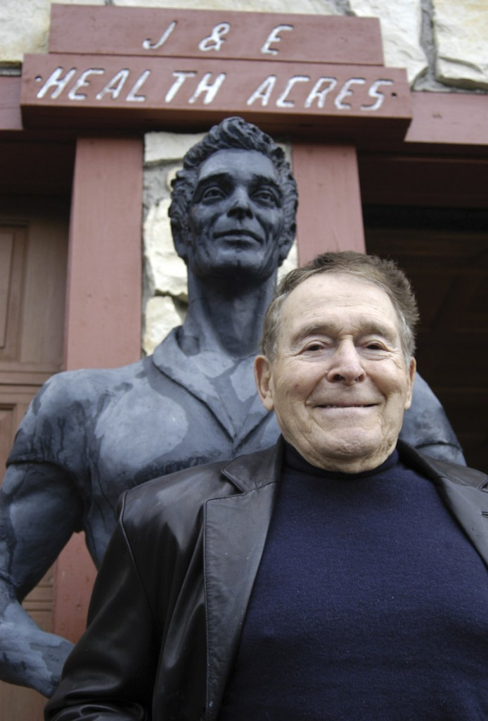 Jack LaLanne poses by a statue of himself in Morro Bay, Calif., in 2003. He promoted fitness before it became a national obsession.