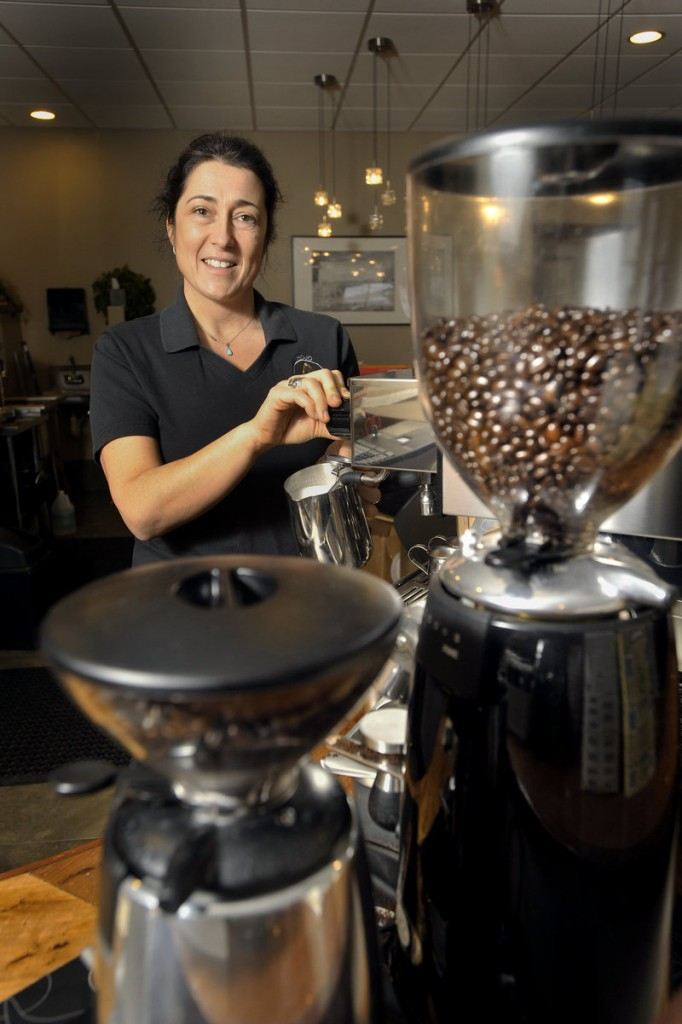 "Jacquelin Bradley, owner of the Mojo Health Bar, prepares a latte for a customer. She opened the business because she ""wanted to offer a healthier alternative to the things we all enjoy each day, like a good cup of coffee ..."""