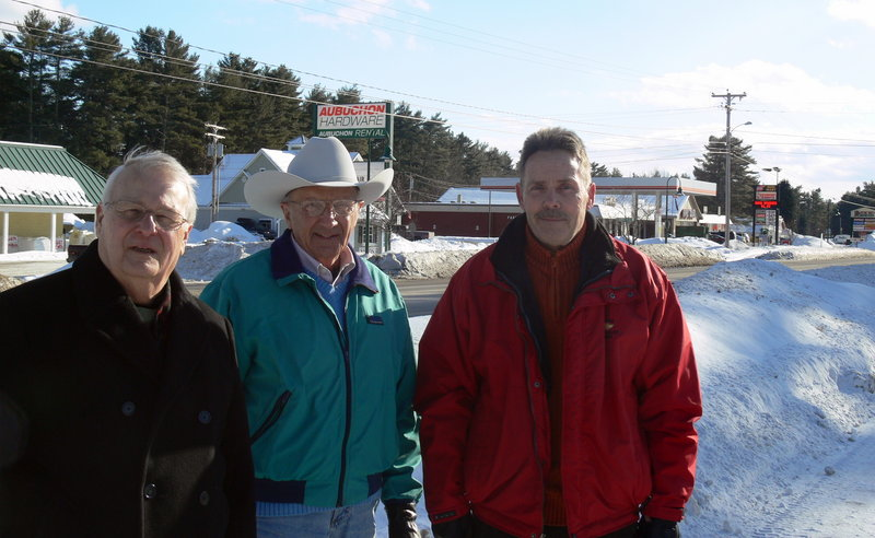 Raymond residents, from left, Sam Gifford, Wayne Holmquist and Ingo Hartig are seeking others to revitalize commerce along Raymond's commercial strip. Not pictured are committee members Frank and Betty McDermott, who have gone south for the winter.