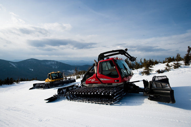 Snow groomers like these modern ones at Sugarloaf have come a long way from the 1960s, when Maine pioneers experimented with new ways to groom the slopes at ski areas.
