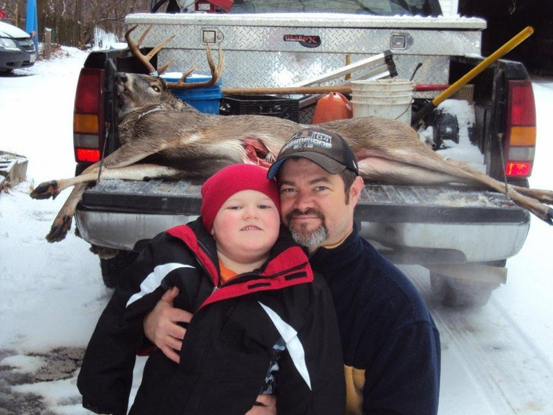 Dean Smith, shown with his son JD, harvested this 8-point, 150-pound buck in Albion during deer hunting season. The buck's rack boasted 7- and 8-inch brow tines and an 18-inch inside spread.