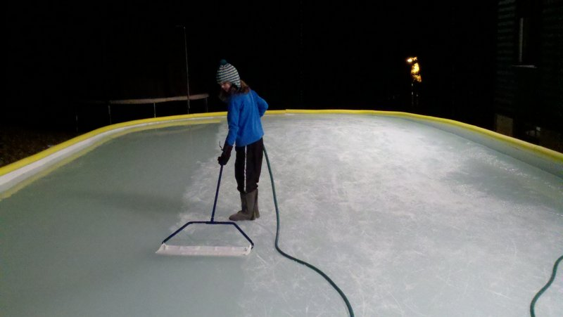 held miniZamboni to smooth the ice on their backyard rink in Camden