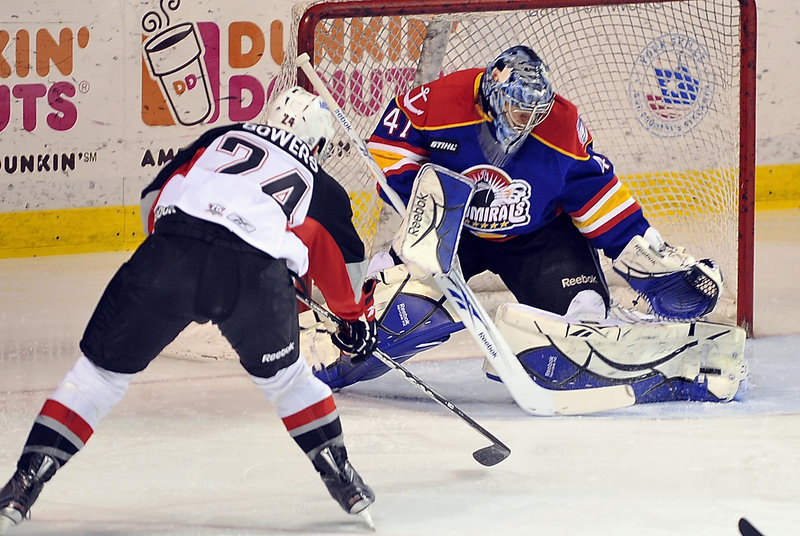 Justin Bowers of the Pirates has his shot blocked by Norfolk goalie Mike Smith Tuesday night, but Portland went on to earn a fourth straight victory.
