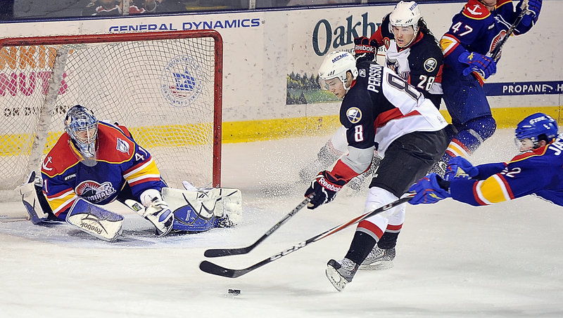 Admirals goalie Mike Smith keeps close watch as Pirate Dennis Persson's shot is broken up by Norfolk's Scott Jackson on Tuesday night at the Cumberland County Civic Center. Looking on is Portland's Dennis McCauley.