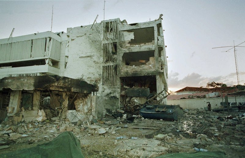 The burned-out wreckage of the U.S. Embassy in Tanzania is shown a day after the blast. Almost simultaneously, bombs hit U.S. embassies in Kenya and Tanzania, killing 224, including 12 Americans, and injuring thousands.