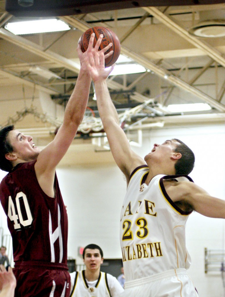 Tanner Storey of Greely, left, competes with Kyle Danielson of Cape Elizabeth for a rebound Tuesday night during Greely's 68-50 victory. The top-ranked Rangers had lost five straight to the Capers.