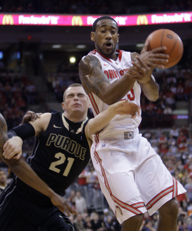 David Lighty, right, of Ohio State is fouled by Purdue's D.J. Byrd while trying to grab a rebound during Ohio State's 87-64 win Tuesday night at Columbus, Ohio.