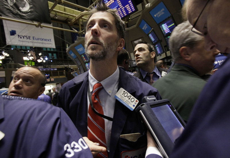 Traders keep their eyes on the numbers Wednesday on the floor of the New York Stock Exchange. Stocks of energy companies gained more than 2 percent.