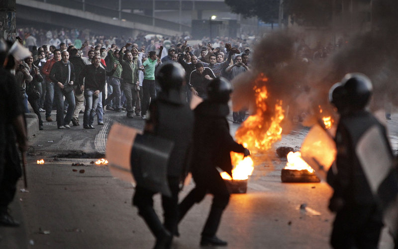 Egyptian riot police clash with anti-government activists in Cairo, Egypt, on Wednesday, the second day of protests in the capital city.