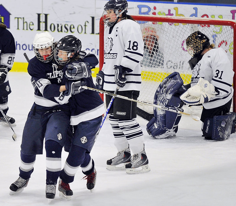 Arie Potter, right, receives a hug from Courtney Barker after scoring with one second to play Wednesday, giving Yarmouth a 6-5 victory against Portland at the Portland Ice Arena. It was Potter's fifth goal of the game. The Portland players are goalie Courtney Rickett and Abbi Scrutchfield.