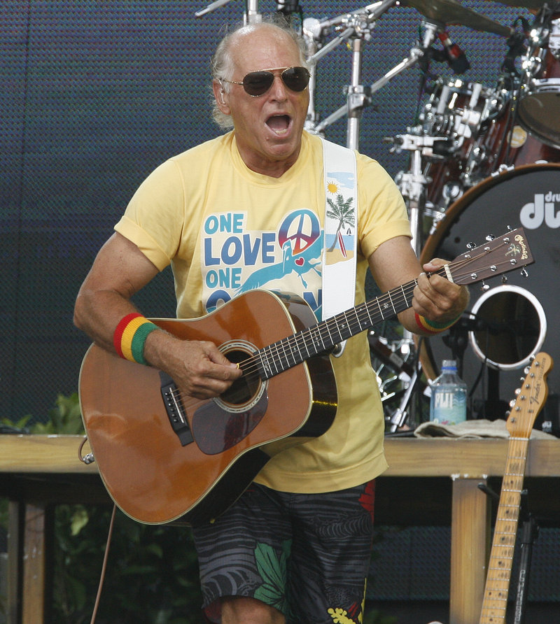 Jimmy Buffett performs in Gulf Shores, Ala., last July. Buffett fell off a stage at the end of a concert in Sydney, Australia.