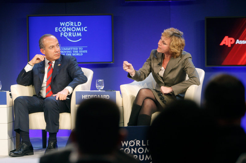 Mexico's President Felipe Calderon, left, and European Commissioner for Climate Action Connie Hedegaard participate in a session on Climate Change at the World Economic Forum in Davos, Switzerland, on Thursday. Calderon said very little can be achieved without U.S. involvement, and he called for a change in American public opinion on global warming.