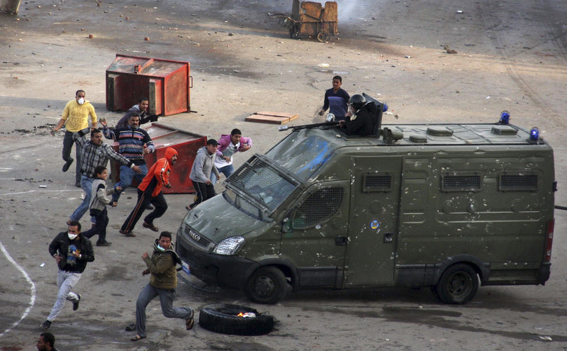 Egyptian protesters clash with riot police in Suez on Thursday. Activists protested for a third day as social networking sites called for a mass rally in Cairo after Friday prayers, keeping up the momentum of the largest anti-government demonstrations in years.