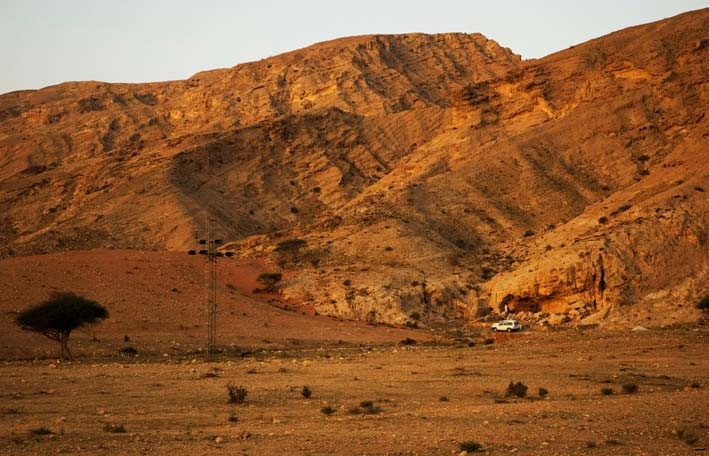A photo provided by the journal Science shows a view of Jebel Faya from the northeast. Modern humans may have left Africa thousands of years earlier than previously thought, heading across the Red Sea into Arabia rather than down the Nile, researchers say.