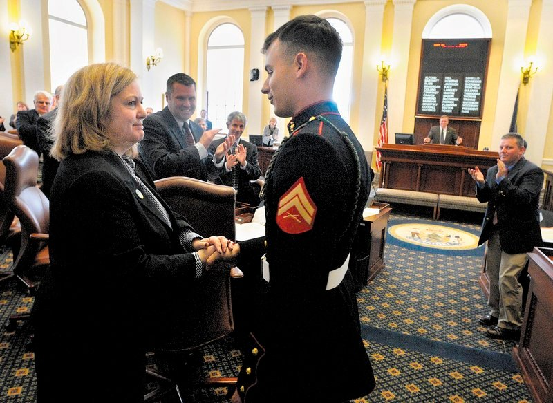 Sen. Deb Plowman, left, shakes hands with Marine Cpl. Joshua Carrier after he was introduced to legislators Thursday in Augusta. Carrier visited the State House after returning from combat duty in Afghanistan. Carrier, who has been deployed overseas twice in his three and a half years in the Marine Corps, needed his parents' signature when he joined the Corps at the age of 17. When his four years are up in June, the 2007 graduate of Erskine Academy plans to go to college. He serves with the 2nd Battalion, 6th Marine Regiment.