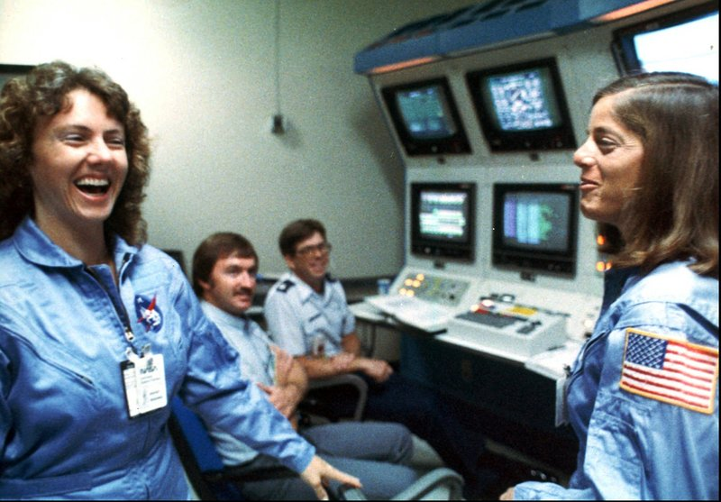 "Christa McAuliffe, left, and Barbara Morgan, her backup, laugh during training in early 1986. ""Imagine a history teacher making history,"" McAuliffe said before the Challenger flight."
