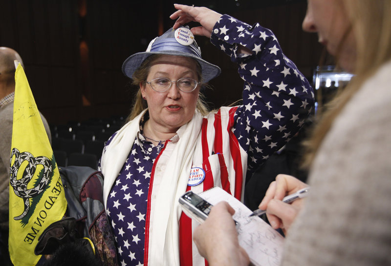 JoAnn Abbott, co-organizer for the Washington, D.C., Tea Party, speaks to reporters at the sparsely-attended Senate Tea Party Caucus on Capitol Hill in Washington on Thursday. The caucus attracted just four senators – out of a possible 47 GOP senators – willing to describe themselves as members.