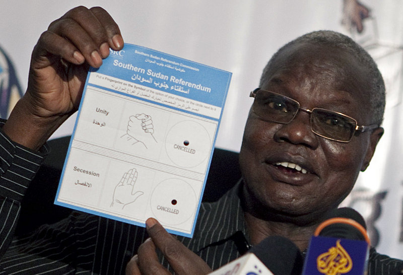 Justice Chan Reec Madut, chairman of the Southern Sudan Referendum Bureau, displays the referendum ballot during a news conference early this month in Juba, southern Sudan.
