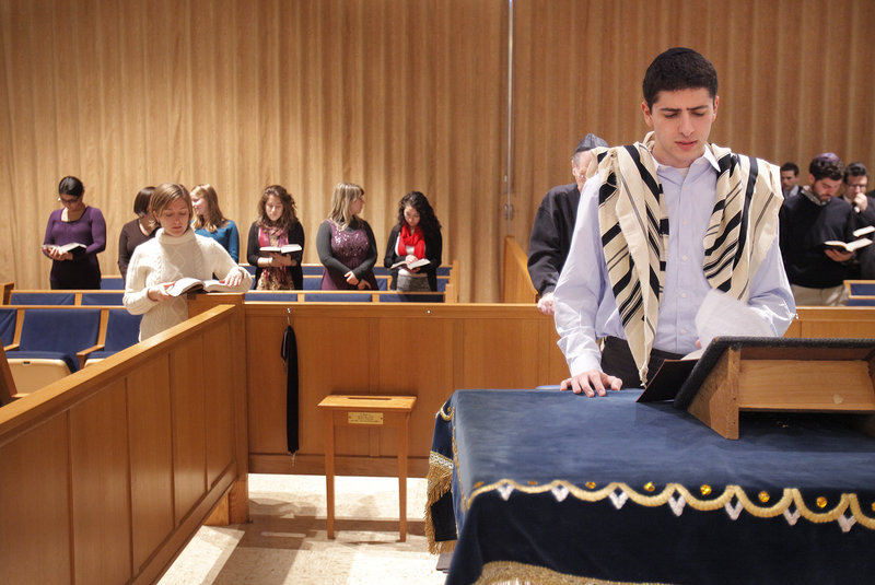 Jacob Agi, a student at Brandeis University, leads afternoon prayers Friday before the start of the Shabbat eve service at Shaarey Tphiloh Synagogue in Portland. College students are spending a weekend at the synagogue to learn more about orthodox Jewish life.