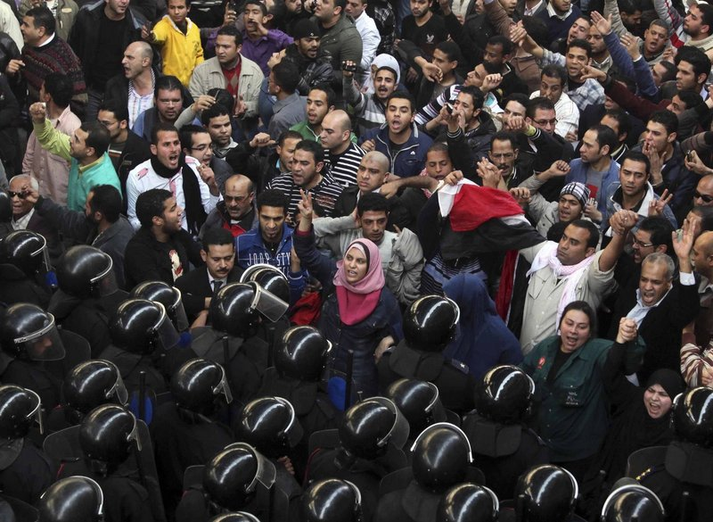 Protesters face riot police in Cairo on Friday as national demonstrations escalated. The capital was the scene of violent chaos as tens of thousands of anti-government protesters stoned and confronted police, who fired back with rubber bullets, tear gas and water cannons.