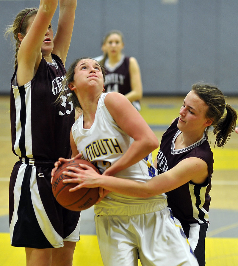 Jackie Doyle of Falmouth tries to go up for a shot while guarded by Greely's Megan Coale, right, and Jaclyn Storey during Friday night's game at Falmouth.