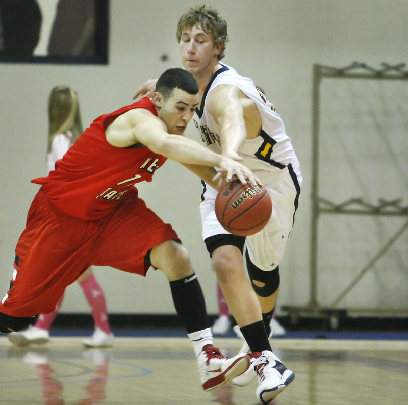 Sean Bergeron, right, of USM tries to beat Cody Snow of Keene State to a loose ball. The Owls took the lead for good with 3:44 left in the game.