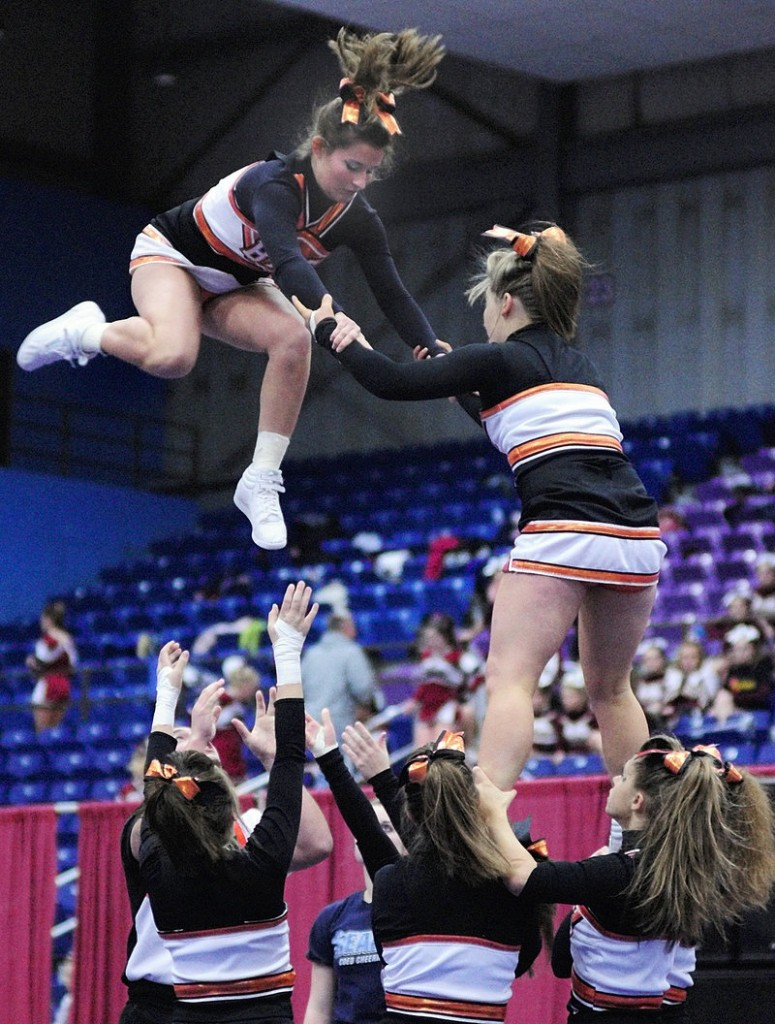 Brunswick cheerleaders Margaret Mathy, left, and Kelsey Thibeault do a stunt Saturday during the Eastern Class A competition at the Augusta Civic Center.
