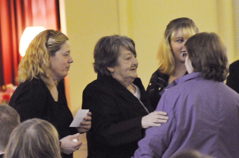 Megan Waterman's mother, Lorraine Ela, left, and grandmother Muriel Benner, center, speak with family and friends before a memorial service for Waterman in Portland on Sunday. Police believe she was murdered by a serial killer.