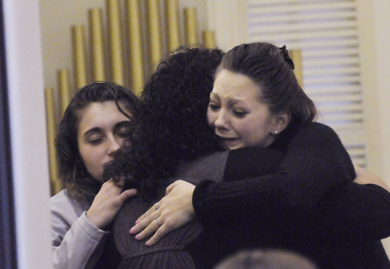Amanda Gove, right, Megan Waterman's sister, is comforted by friends during visiting hours before a memorial service on Sunday.