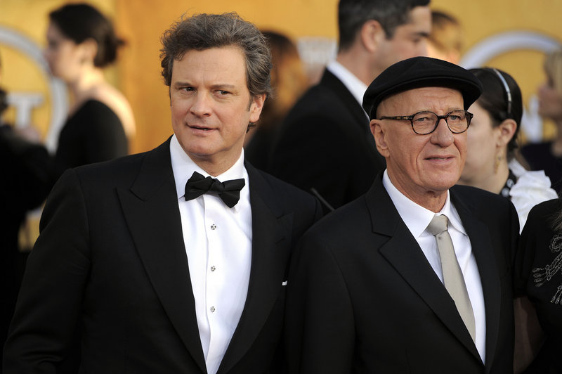 Colin Firth, left, and Geoffrey Rush arrive at the 17th Annual Screen Actors Guild Awards on Sunday.