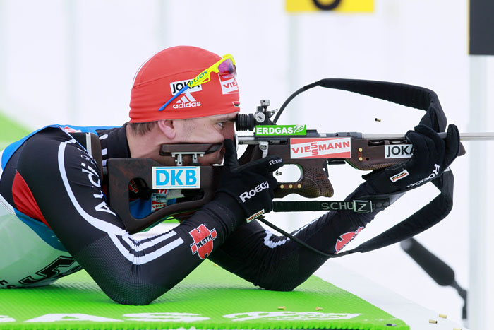 Arnd Peiffer, of Germany, shoots from the prone position on his way to winning the men's 10-kilometer sprint at the Biathlon World Cup today in Presque Isle.