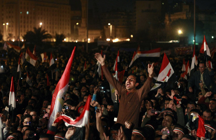 Egyptians celebrate the resignation of President Hosni Mubarak in Tahrir Square in downtown Cairo today.