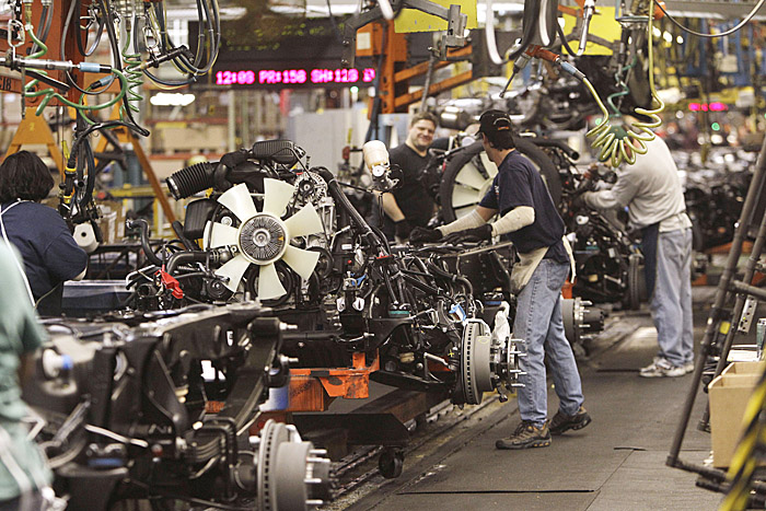 An engine is joined to the chassis on the General Motors Silverado and GMC Sierra heavy-duty pickups assembly line recently in Flint, Mich.