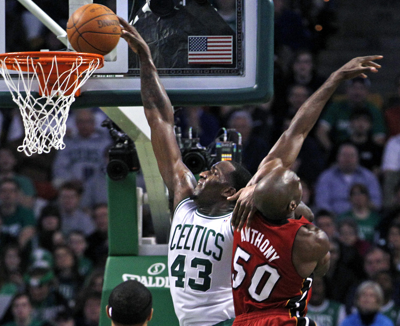 Kendrick Perkins of the Celtics scores over Heat center Joel Anthony in Sunday's game at Boston. The Celts won, 85-82.